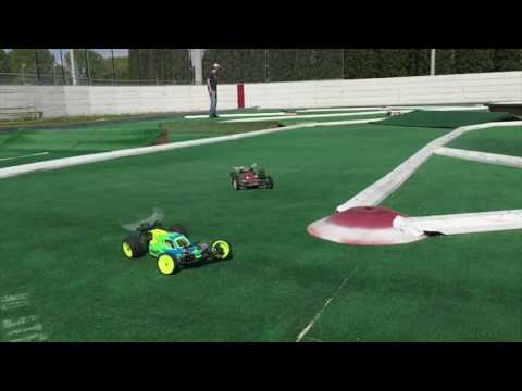 Slow motion off road rc car racing on artificial grass