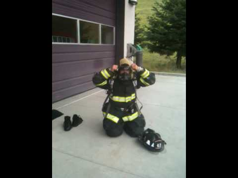 Firefighter getting dressed