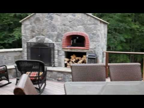 Outdoor Kitchen and stone fireplace with pizza oven built into this deck