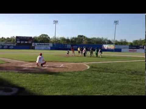 KCC President Dr. Dennis Bona throws the first pitch