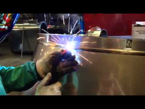 MIG welding on thin stainless steel sheet metal.
