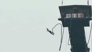 A daredevil in Beijing nearly escaped death after a bungee jump