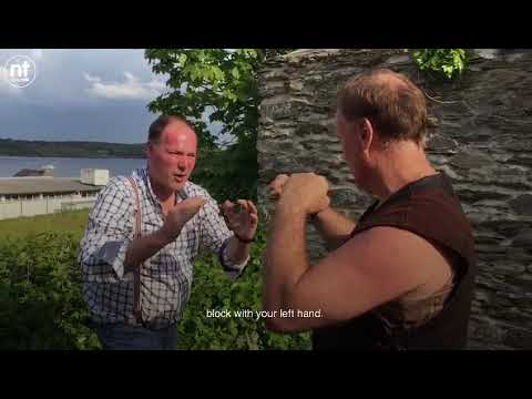 Stuntman Peter Dillon teaches Henry McKean some fight moves