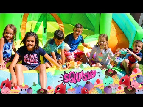 Giant SQUISHY TOYS POOL & Waterslide With The Ohana Adventure Olympics