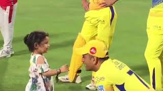 Dhoni playing with his daughter Ziva