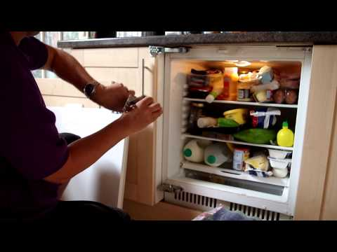 Under counter integral refridgerator door Hinge replacement demonstration