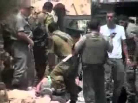 Israeli soldier shoots blindfolded and handcuffed Palestinian man at point blank range VIDEO   YouTube