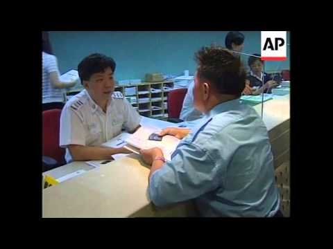 HONG KONG: RESIDENTS PREPARE TO RECEIVE NEW CHINESE PASSPORTS