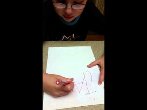 Autistic child writing his name
