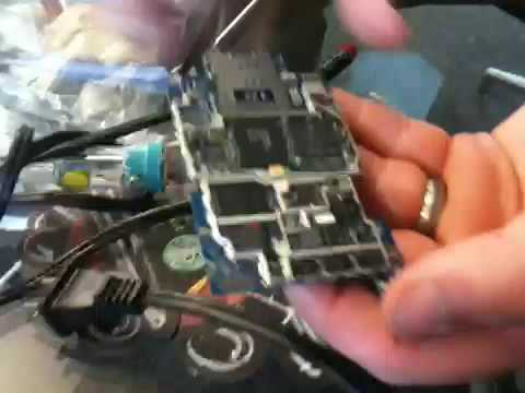 iFixit.com with iPhone 3GS' naked logic board - 3G upload