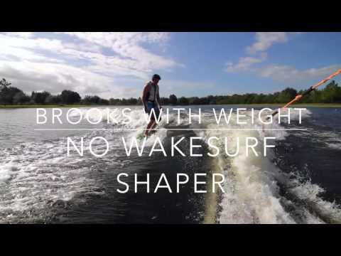 Eight.3 Wakesurf Shaper Behind A Waterski Boat