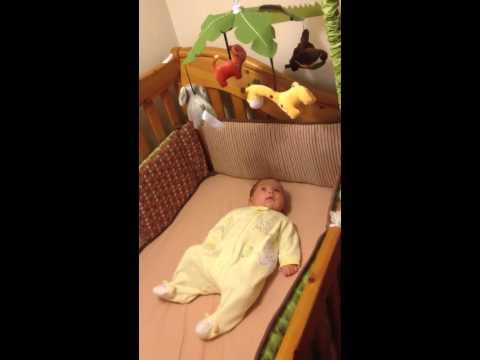 Elizabeth enjoying her crib mobile
