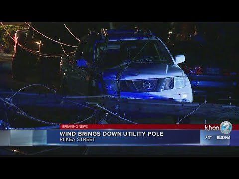 Wind brings down utility pole