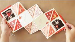 Decoraciones para la carta: http://bit.ly/1hBGwOk  || descarga el papel deco: http://craftingeek.me/papel-deco/ ► COMPRA LOS MATERIALES: http://www.holadiy.com     SUSCRIBETE http://bit.ly/PonteCrafty  ♥ TIENDA http://www.holadiy.com  ♠ SNAPCHAT craftingeekliz ♦ FACEBOOK http://www.facebook.com/craftingeek ♥ TWITTER http://www.twitter.com/craftingeek ♣ INSTAGRAM http://instagram.com/craftingeek ♠ PINTEREST http://bit.ly/CGurlP  {perdon de nuevo por la voz, me estaba quedando afonica :S}  Hola! en esta ocasion te dejo esta carta/tarjeta que se llama SQUASH, en inglés quiere decir aplastar, pero no me gustó como se oía el nombre asi que le deje Squash. Basicamente se dobla y parece un acordeon que queda cuadrado. Espero te guste! es una genial idea muy facil de hacer, linda y original (barata tmb) manualidad 14 de febrero, manualidad para regalar a tu novio o novia, a algun amigo, por cumpleaños o por lo que a tí se te ocurra :)  [english: Learn how to do a Squash Card step by step. Download the graphics from here: http://bit.ly/1hBGwOk]  Música:   Kevin Macleod | www.incompetech.com
