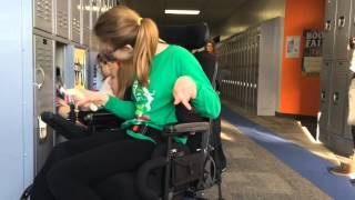 Watch six-grader with cerebral palsy open redesigned locker