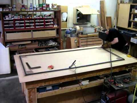 Welding the mirror window frame for Riffle