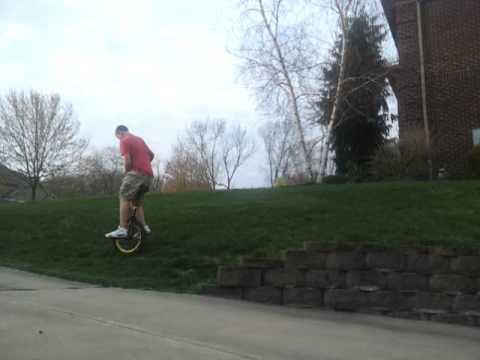 Unicycle 180 jump off wall