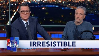 Jon Stewart Climbs Out From Under Colbert's Desk To Debut