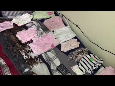 Organizing the babies clothes by theme