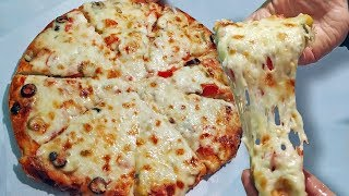 #x202b;بيتزا المحلات بكل أسرارها جبنة مطاطية عجينة هشةوطرية..من الأخر هخليكي أستاذه فيها#x202c;lrm;