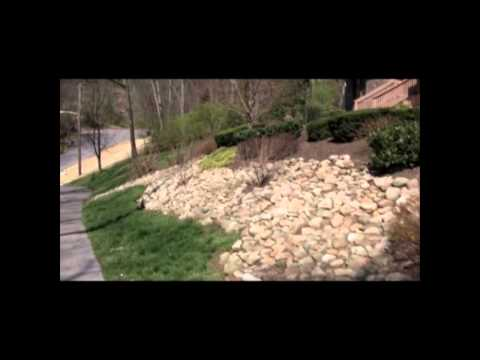 Video showing a slope landscaped with natural stone and shrubs. Nashville-landscaping-slope-hill.mp4