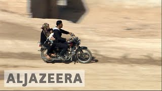 Thousands of Syrians flee to de-escalation zones for safety