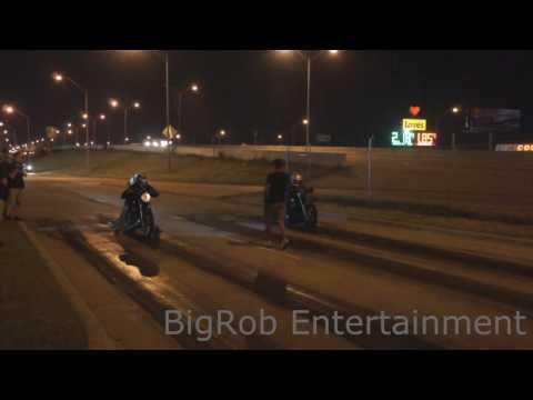 Guys lays bike down during street race