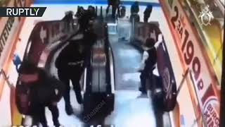 Child sends younger kid down mall escalator in trolley (Warning: DISTURBING)