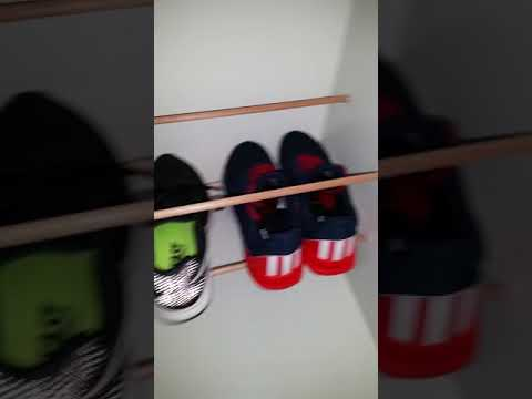Easy to make shoe rack, 10mm dowels, roof nail caps cut in half, stuck on with hot glue,