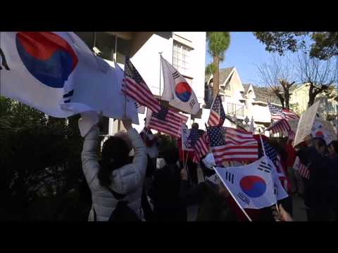 Student takes down North Korean flag after pressure from outside protest