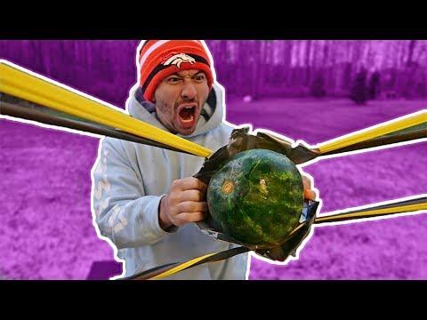 WORLD'S LARGEST RUBBER BAND SLINGSHOT vs. FRUIT NINJA!!