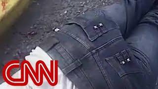 Bodycam shows officer shoot man wearing headphones