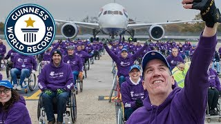 Heaviest aircraft pulled by a team of wheelchair users - Guinness World Records