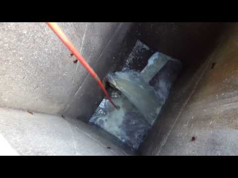 Unblocking a blocked sewer connection at a manhole.