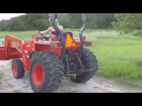 Kubota Tractor Driving Girl