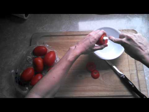 Quick trick to clean the gunk out of Roma tomatoes