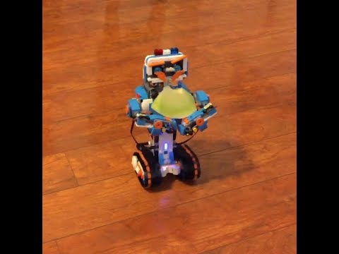 Boy building programmable robot with Lego Boost