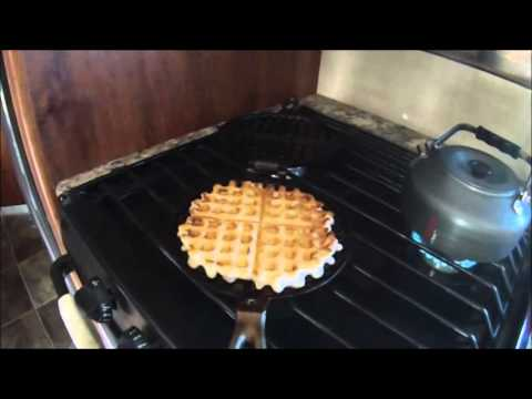 Making waffles in cast iron waffle maker