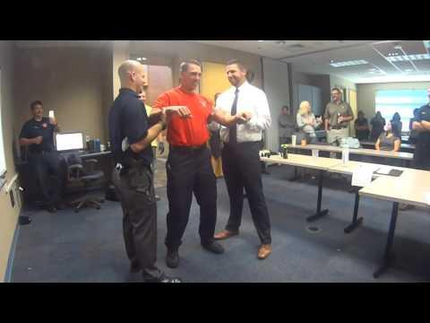 Wausau Firefighters Volunteer for a Taser Exposure