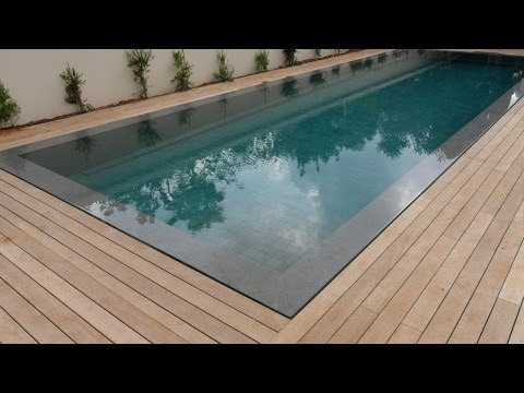 Teak decking installation around swimming pool with hidden fasteners
