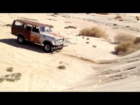 Toyota land cruiser in the sand dunes(: