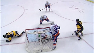 Penguins come close twice in OT but Halak somehow keeps puck out