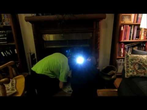 Tommy helps his dad rescue a squirrel from our fireplace