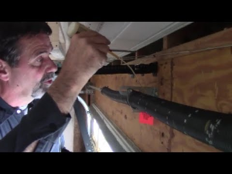 Garage door parts to lubricate, clean - every year use oil, grease, or silicone