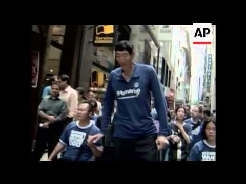 At almost 8 feet tall, the world's tallest living man takes a trip to Brazil.