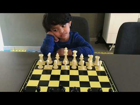 Kid playing chess for the first time