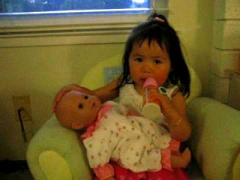 Elissa feeds her baby DOLL