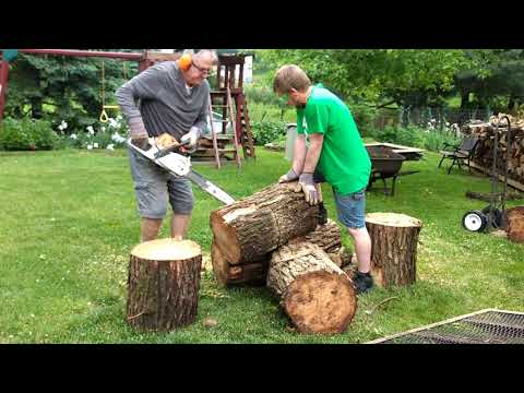 Pop-pop and Bryan cutting wood, a family tradition