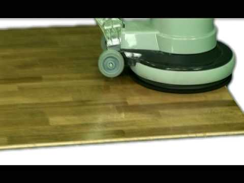 Buffing a dirty floor clean with Faxe Maintenance Oil.