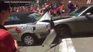 Video shows car ramming into protesters in Charlottesville